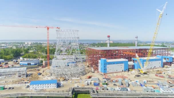 Panorama unfinished industrial constructions at thermal power plant against amazing landscape under clear sky