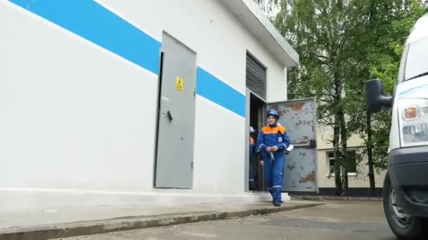 company employees go out of electrical distribution substation