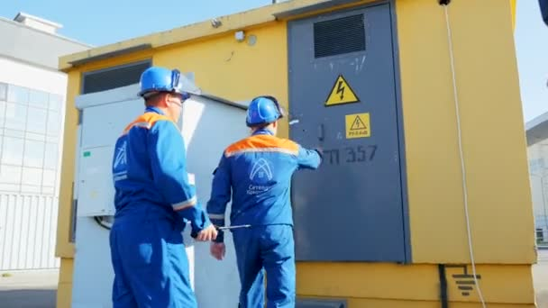 employees enter premises with electrical equipment and warning sign