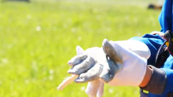 person takes off double rubber and cotton electrician gloves and unscrew rubber