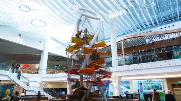 timelapse amazing playground with carpets planes among shopping mall