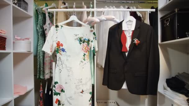 dress with floral print and jacket with bow-tie in wardrobe