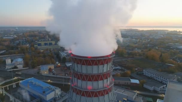aerial motion around white steam pillar above cooling tower