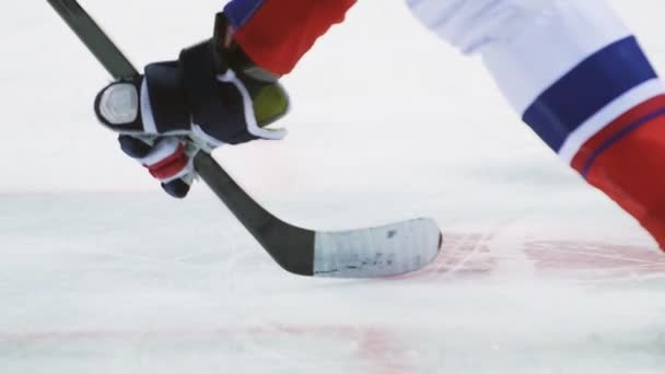 hockey players fight for puck with sticks on arena closeup