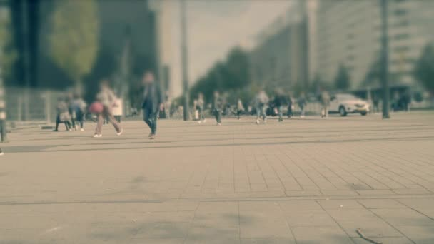 Beautiful motion blur with group of multiracial people walking on street in a European city. Crowd people