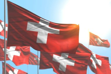 nice many Switzerland flags are wave against blue sky picture with bokeh - any feast flag 3d illustration