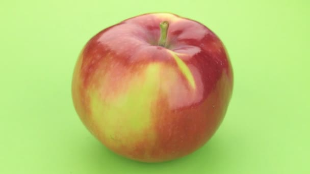 Rotation of a ripe red apple. Isolated