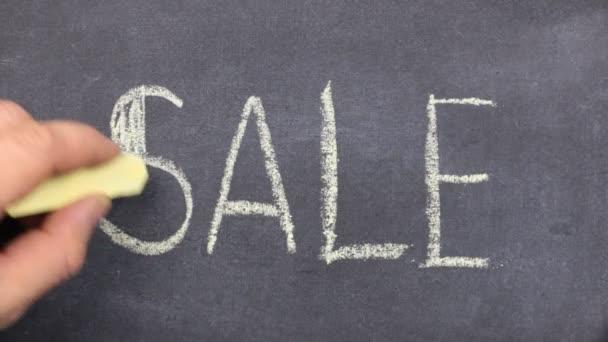 Word SALE is written in chalk on a blackboard. Stroke along the contour with chalk.