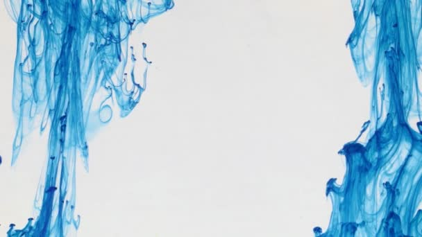 Drops of blue paint with empty space in the center.