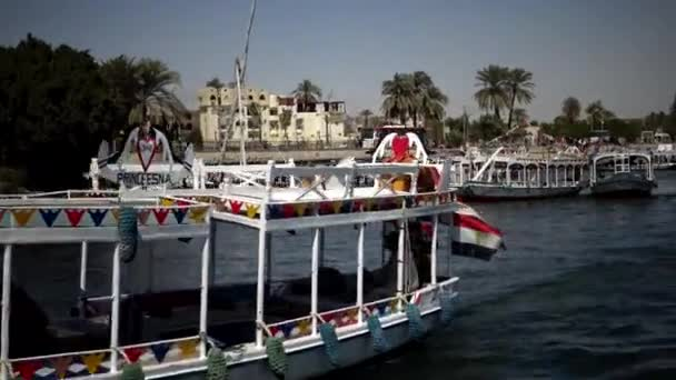 LUXOR, EGYPT - APRIL 5, 2019: Touristic boat on Nile river in Luxor, Egypt