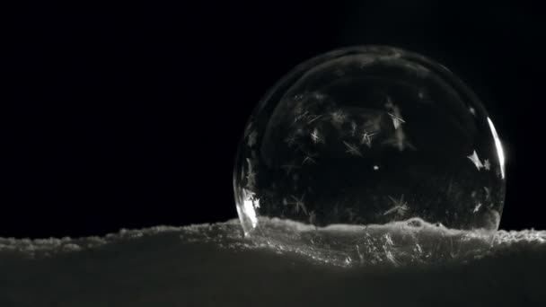 Dark Ice ball with freezing crystals