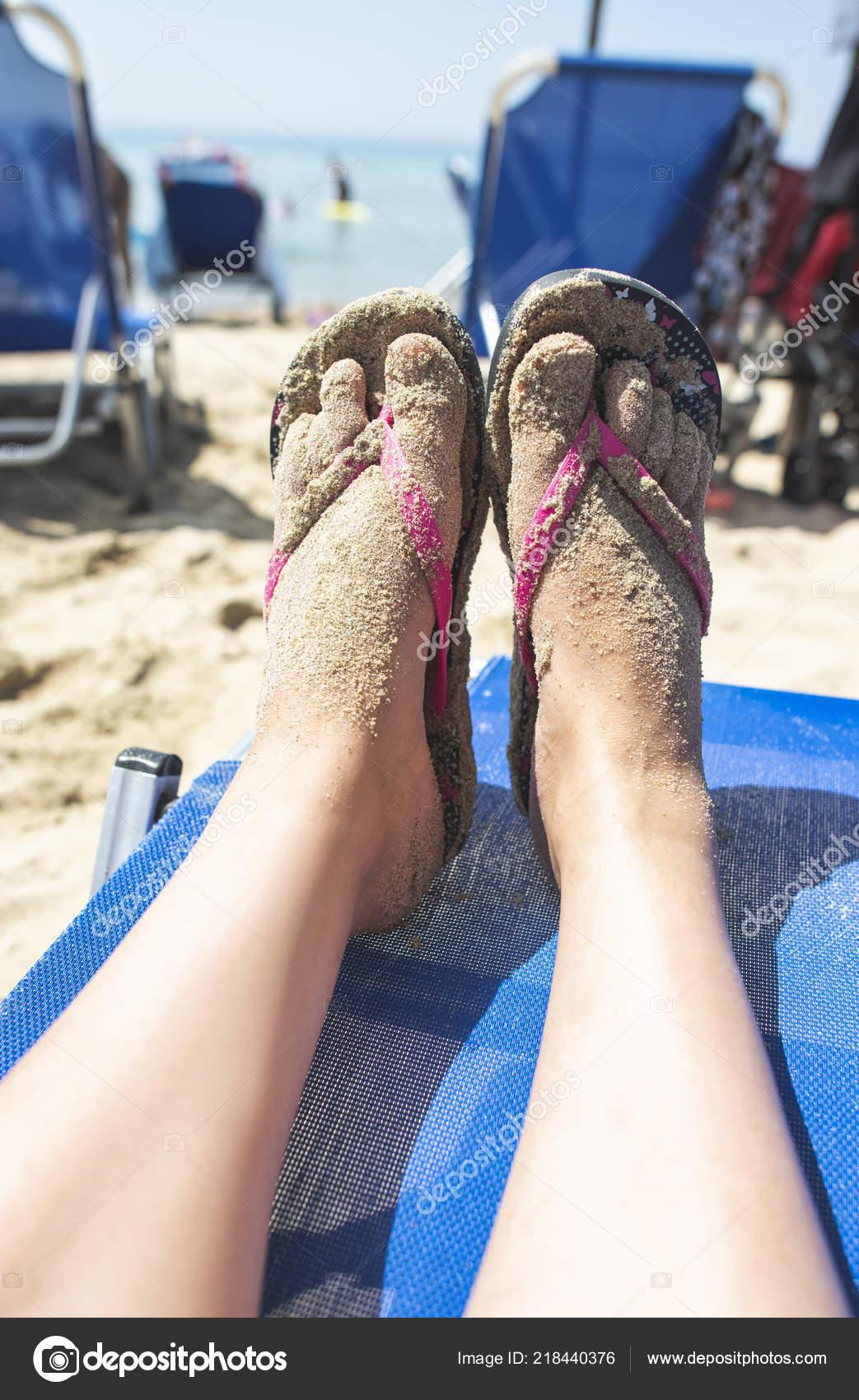 2a926fb41cb25 Depositphotos stock photo woman feet flip flops beach jpg 1043x1700 Beach  feet flip flops