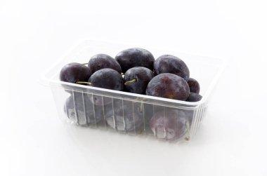 Fresh purple plums in Plastic food box