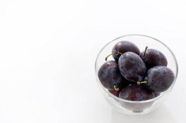 Fresh purple plums in Glass bowl