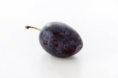 Fresh purple plums on white background