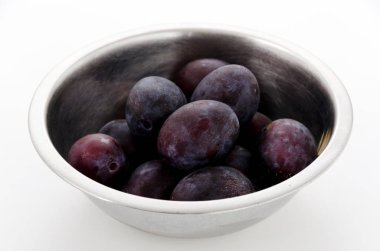 Fresh purple plums in Stainless steel bowl