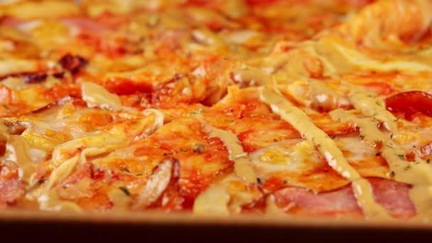 Freshly prepared pizza in a cardboard box.