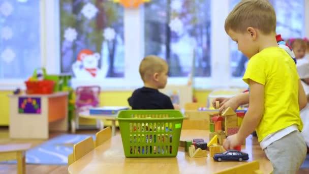 preschool education - happy children in kindergarten have fun playing together