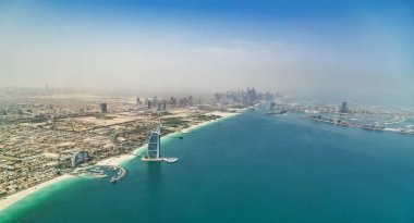 Aerial view of Dubai Marina downtown with palm island. Panoramic view of modern city.