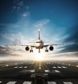 Fotografie Commercial airplane taking off runway in day light. Concept of modern fast traveling