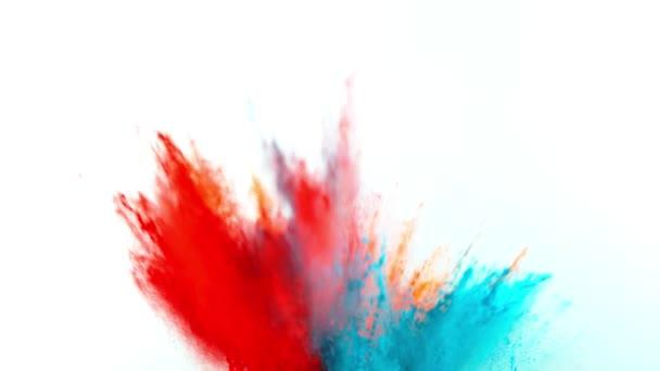 Szuper lassított felvétel színes por robbanás elszigetelt fehér háttérrel. Filmre véve nagy sebességű mozi kamera, 1000fps.