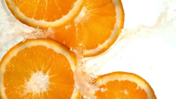 Super slow motion of orange slices with water splash. Filmed on high speed cinema camera, 1000 fps.