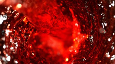 Detail of red wine whirl