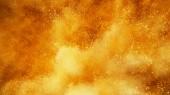 Výbuch zlatého prášku.