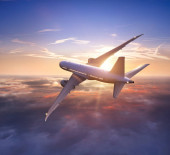 Photo Passengers commercial airplane flying above clouds