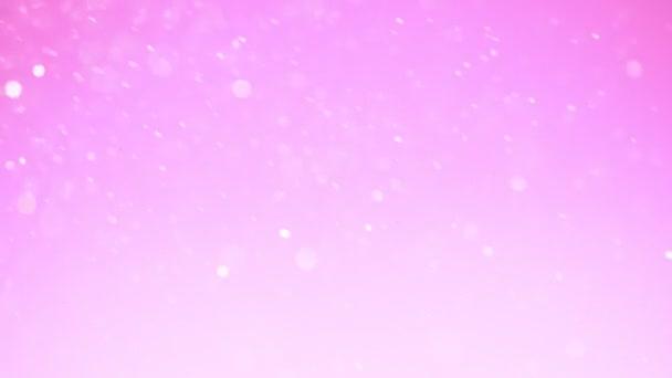 Szuper lassú mozgás csillogó rózsaszín részecskék. Sekély mélységű fókusz. Forgatták a nagysebességű mozi kamera, 1000 FPS.
