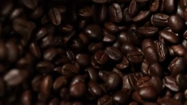 Super slow motion of rotating coffee beans in mill, speed ramping cut. Filmed on high speed cinema camera, 1000 fps.