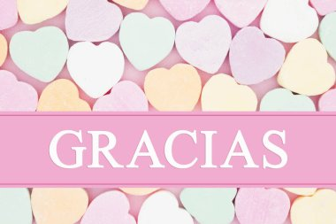 Retro Spanish thank you message, Retro heart shaped candy on pick fabric with text Gracias