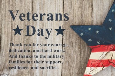 Veterans Day message thanking the military and their families text with USA patriotic old star on a weathered wood
