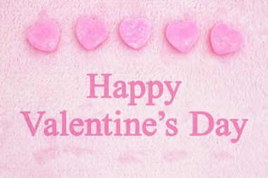 Old fashion Valentine's greeting, Retro heart shaped candy on pick fabric with text Happy Valentine's Day