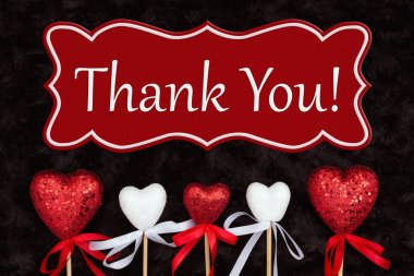 Thank You message with white and red hearts on black rose textured plush fabric