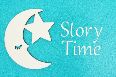 Story Time message with a wood moon and star
