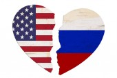 Fotografie American and Russian flags in a broken heart