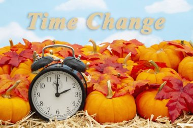 Time change message with a retro alarm clock with pumpkins and f