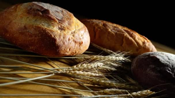 Homemade bread and ears of wheat