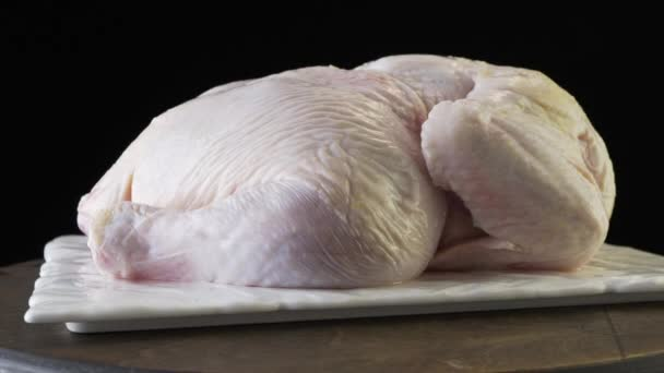 Peeled broiler chicken on a black background
