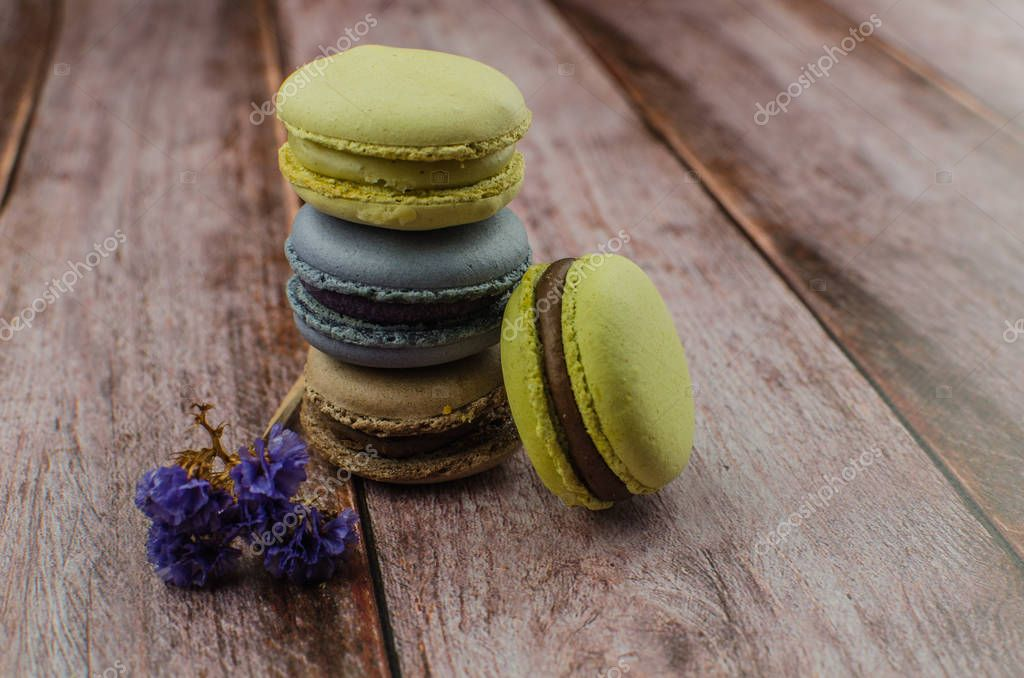 French macaroon cake. Macaroons in box with dried flowers