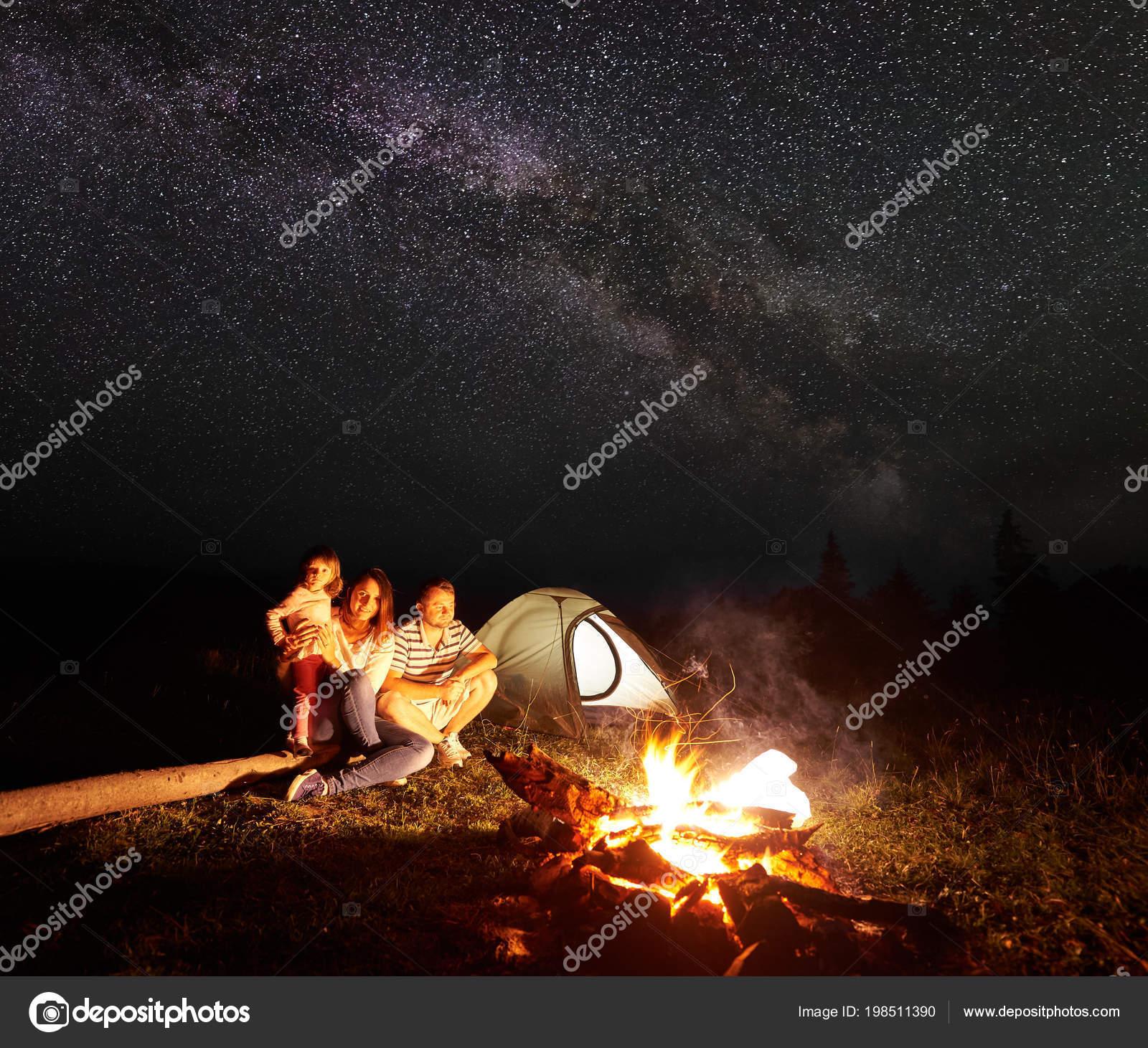 Family Camping Mountains Night Sitting Front Illuminated Tent Burning Bonfire Stock Photo