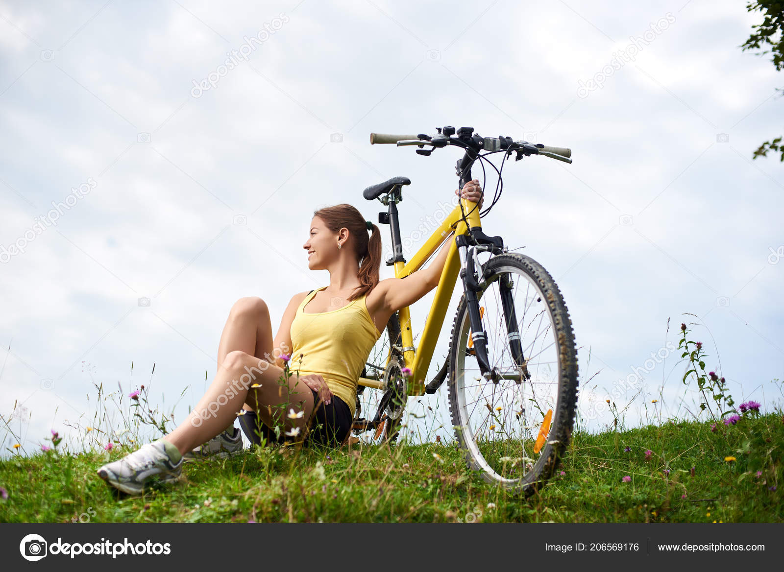Young Happy Woman Biker Sitting Grassy Hill Yellow Mountain