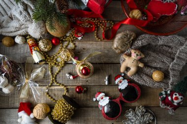 Handmade Christmas toys and decorations, warm woolen hats on wooden rustic background
