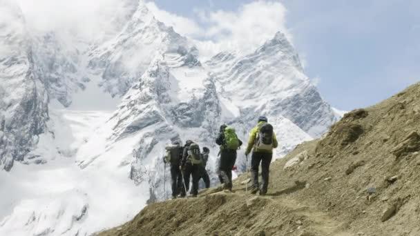 A lot of backpackers on the trekking Larke Pass in Nepal. Manaslu area.