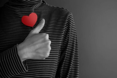 Customer Experience Concept. Happy Client with Thumb Up and a Red Heart. Meaning and Symbol of Impressive Products and Services