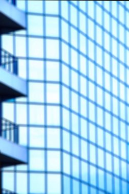 Abstract defocused background.A high-rise office building with blue glass windows