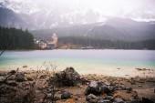 Fotografie The Lake Eibsee in Alps at rain weather in spring, Garmisch-Partenkirchen, Germany