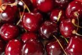 Sok érett finom cseresznye. Berry háttér.