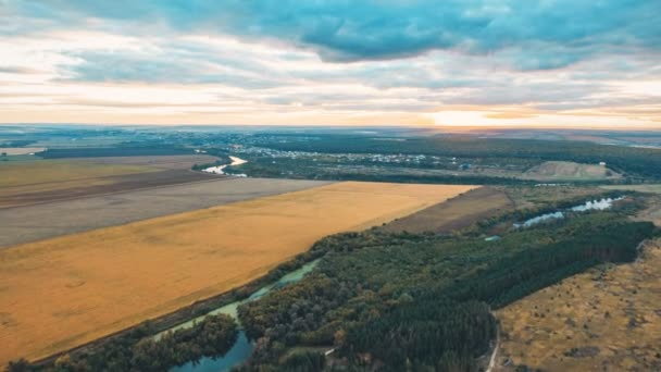 Tine lapse Sunset in a beautiful countryside flight among the river, forests, fields and beautiful cumulus clouds